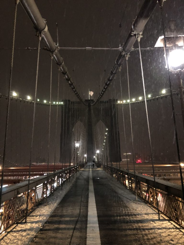 On the Brooklyn Bridge NYC at snow