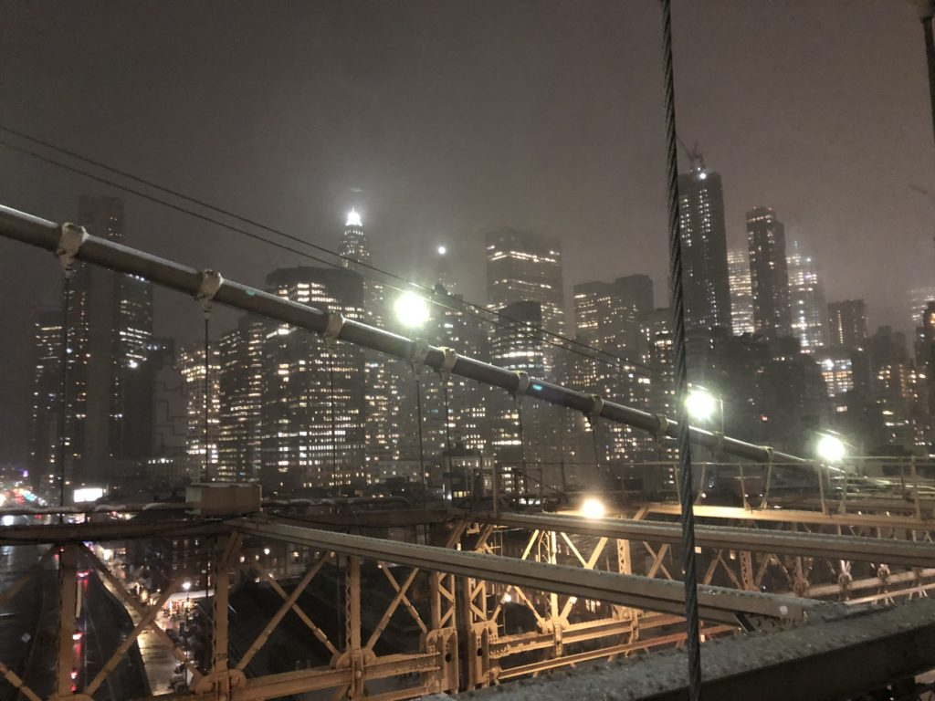 view to manhattan from brooklyn bridge at wintertime
